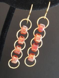 Bead chain earrings #handmade #jewelry #beading/Not so much as earrings, but I think it would look great turned sideways and layered like a bib necklace.