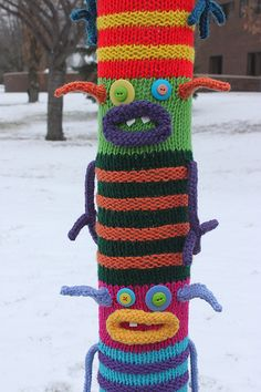 "Erin B.'s amazing ""Monster Totem"" yarn bomb. BEST IN SHOW! See more of her monstrously great work at http://www.erinmakesstuff.com/"