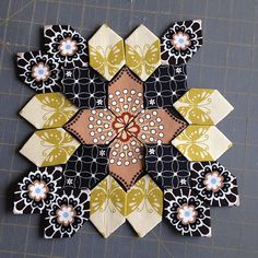 Cut out another Lucy Boston block - could only get seven flowers out of the…