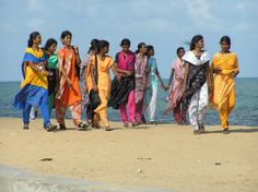 Pondicherry, India - locals enjoy a stroll on the beach.