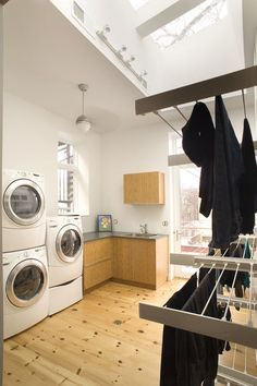 This laundry area has not one, but three washers and dryers — a luxury for some but a necessity for this large family.