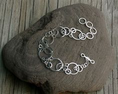 Saturn's Moons handmade hammered sterling silver by erin hewgley.