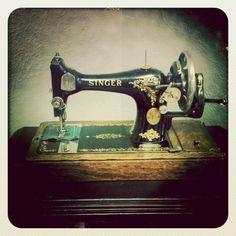 Vintage hand-crank sewing machine.