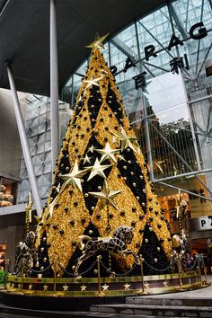 Christmas tree at the Paragon Shopping Centre, with carousel below. (I collected carousel horses so I have a thing for them.)