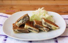 Quadrotti di frittata ai funghi , un piatto che può servito come antipasto, finger food, come secondo piatto, facile e veloce da preparare è molto gradito..