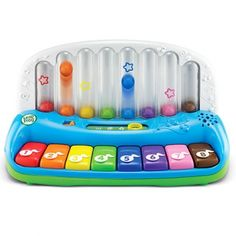 Little fingers can use musical sounds to learn about numbers, colors, and songs. The singsong piano tunes foster language development while the vibrantly colored piano keys make the corresponding colored balls pop, teaching the concept of cause and effect.                 Copyright