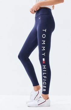 Hit the gym in style with the Side Logo Leggings from Tommy Hilfiger. These high-rise leggings feature an elastic waistband, logo graphic at the side, and a tight fit. Mode Tommy Hilfiger, Tommy Hilfiger Leggings, Tommy Hilfiger Outfit, Tommy Hilfiger Women, Tommy Hilfiger Clothing, Tommy Hilfiger Fashion, Tommy Hilfiger Sweater, Legging Outfits, Sporty Outfits