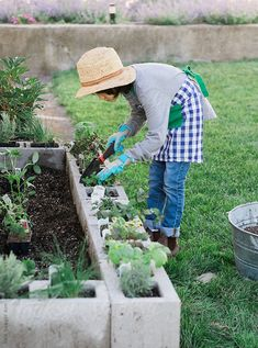Boy makes organic vegetable and herb garden by KelliSeegerKim   Stocksy United