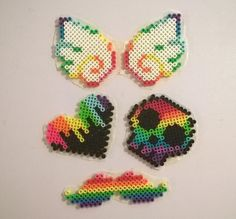 A collection of rainbows #diy #perlerbeads #perlerbeadart #perlerbeadsprites #rainbow #wings #heart #mustache #skull