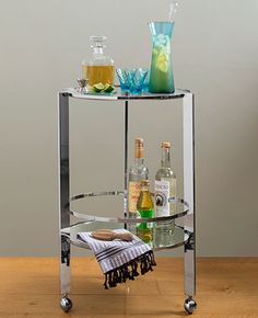 The gleaming chrome-and-glass construction of this bar cart seems retro and futuristic all at once. About $179; CB2