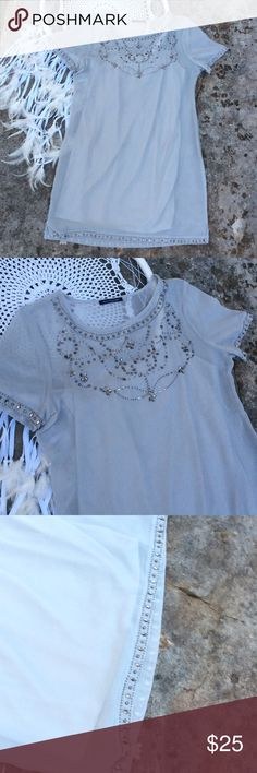 Gorgeous grey shift dress Gorgeous light heather grey shift dress with jeweled collar. Sequined around the bottom and sleeves. In flawless condition and has non attached slip American Eagle Outfitters Dresses