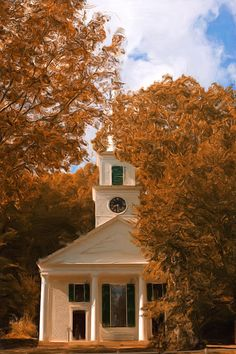 Old colonial church surrounded by colorful fall foliage in Sturbridge, Massachusetts...New England.