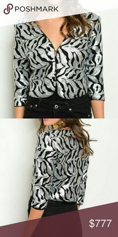 """Sassy animal print sequin jacket Brand new!  Just in time for the holidays. Grab the sassy sequin animal print crop jacket to pair with any of your holiday outfits to add some pizzazz! This crop jacket is slathered in silver and black sequins. Lined with black lining.  100% polyester  Small Bust 16.5/ Length 17"""" Medium Bust 18"""" across /Length 18"""" Large Bust 19.5"""" across /Length 18"""" Please see measurements Jackets & Coats"""