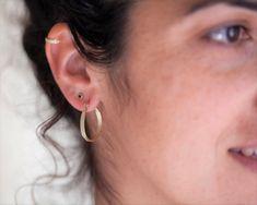 Gold hoop earrings Solid gold hoops Unique hoop earrings | Etsy Rose Gold Nose Ring, Gold Nose Rings, Gold Hoop Earrings, Etsy Earrings, Unique Earrings, Spiderbite Piercings, Piercing Ring, Unique Nose Rings, Gold Nose Hoop