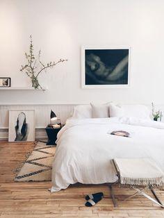 Serene white bedroom.