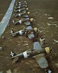 Balkans, Line up of Macchi Mc 200 of the Squadriglia with the typical yellow engine cowling. Ww2 Fighter Planes, Ww2 Planes, Fighter Jets, Ww2 Aircraft, Military Aircraft, Italian Air Force, Vintage Airplanes, Aviation Art, Military History