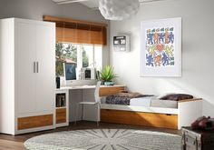 #Dormitorio de #madera natural formado por #cama nido, #mesa #estudio y módulo con dos cajones. #Armario de dos puertas 100x205 cm opcional. / #Dormitori de #fusta natural format per #llit niu, #taula estudi i mòdul amb dos calaixos. #Armari de dues portes 100x205 cm opcional.