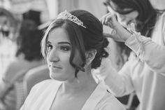 Beautiful bride with up do and tiara at Careys Manor Hotel wedding.