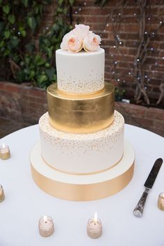 elegant gold and white wedding cake with floral topper ~ we ❤ this! moncheribridals.com