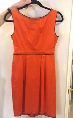 A-line, bright orange dress with buttons on the front and dark contrast stitching. By Moschino Cheap & Chic. Size 4.