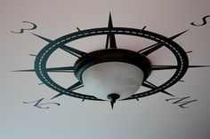 Compass around a ceiling light. Also good for water themed room.