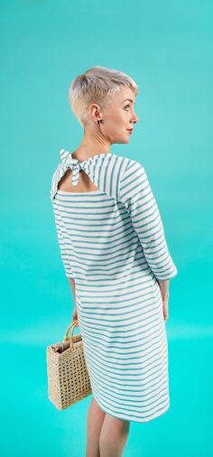 Upgrade your casual me-made wardrobe with this stylish (and comfy!) top and dress. The optional back ties or contrast binding add a fun twist to the classic Breton or t shirt dress.  Romy has a modern loose fit and high slash envelope neckline, with choice of cap, three quarter or full length sleeves for year-round style. Designed for knit fabrics, whip it up on either a regular sewing machine or overlocker (serger). Once you've made one, you'll be hooked!   #sewingpattern #stripeydress #sew