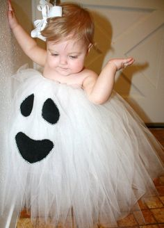Simple ghost halloween outfit made with a Tutu, some black fabric, and a glue gun :)