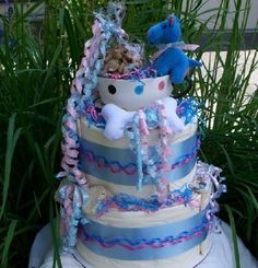 "Blue Tea Cup Pup 2Tier #Puppy Shower #Gift ""Cake"" Centerpiece by Purrfectly Rebarkable #Pets This 2-Tier mega cake makes a great new puppy gift or a birthday gift for an older small breed dog using training pads! With 30 house training pads creating the inedible cake form, toys and rawhide treat decorations, blue satin ribbon and curls for frosting, this makes an adorable display for any puppy shower or pet related party!"