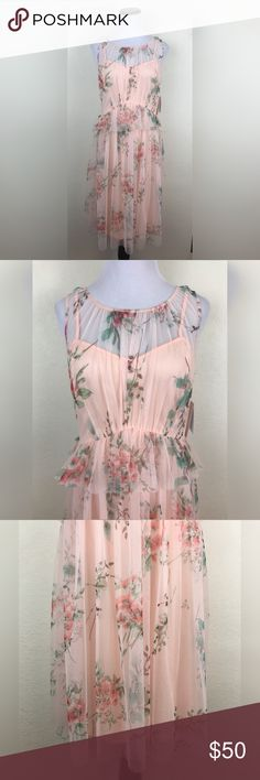 """LC Lauren Conrad Sleeveless Floral Tulle Dress LC Lauren Conrad dress that is brand new with tags.   Size: 6 100% Polyester Armpit to Armpit: 16 1/4"""" Length: 40 1/2""""  Comesfrom a smoke free home. LC Lauren Conrad Dresses"""