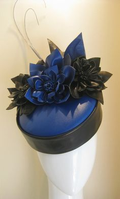 A stunner for autumn/winter racing in colbot blue leather pillbox, edged in softest black and finished with abstract leather flowers and leaves in matching colours. Two grey quills come from the back for a bit of height. Leather Accessories, Hair Accessories, 1920s Hats, Races Outfit, Fall Hats, Diana, Leather Hats, Collor, Cocktail Hat