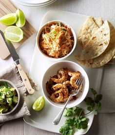 Australian Gourmet Traveller recipe for soft prawn tacos with coleslaw, avocado and coriander.