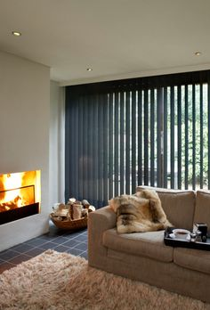 Cosy living room decor furnished with lovely Vertical blinds.