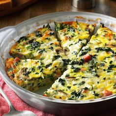 Crustless Spinach Quiche Recipe -I served this quiche recipe at a church lunch, and I had to laugh when one guy told me how much he doesn't like vegetables. He, along with many other people, were surprised by how much they loved this veggie-filled crustless quiche recipe! —Melinda Calverley, Janesville, Wisconsin
