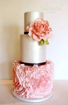 Pink gold wedding cake 3 tiers with flowers - I like how the flower is similar to dress.
