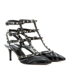 http://www.mytheresa.com/en-de/rockstud-leather-and-calf-hair-kitten-heel-pumps.html