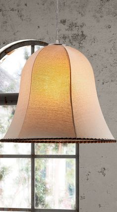 Place a 100-watt bulb in our Granite Ceiling Lamp, and the bright light will be softly diffused through its linen shade.