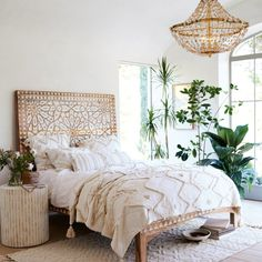 FYI: sweet dreams are made of tufted throws, neutral shades, and intricately carved headboards.