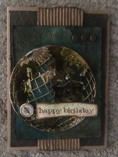 Birthday card for my son using Tim Holtz Globe thinlit die and Ken Oliver's Colorburst.