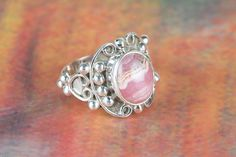 Gorgeous Rhodochrosite Gemstone Ring Handcrafted with Glimmering 925 sterling silver.This Adorable Rings will become your favorite go-to accessories to add a little sparkle to any outfit! .It is great for casual wear or for dressing up, this will make good sense in your Personality.It's all in how you choose to wear it!    Description   •Handmade item  •Material: sterling silver  •Stone: Rhodochrosite   • Ships worldwide from India    All Custom Ring Sizes are Available.  Kindly measure…