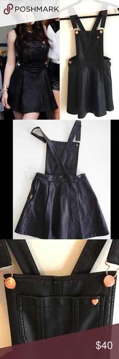 Black Faux Leather Overall Dress Black faux leather overall dress from Kendall and Kylie's first collection. Has adjustable straps, pockets, and rose gold buttons. Excellent condition Kendall & Kylie Dresses Backless