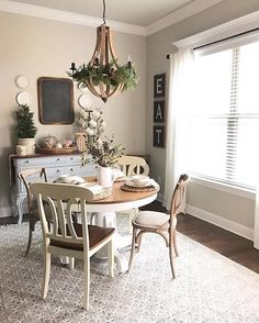 Wooden statement lighting and mix styled seating, create a rustic meets chic dining area a la @ourvintagenest's cozy kitchen setup | Get ready-to-shop #LTKhome details with www.LIKEtoKNOW.it | http://liketk.it/2q2ie #liketkit