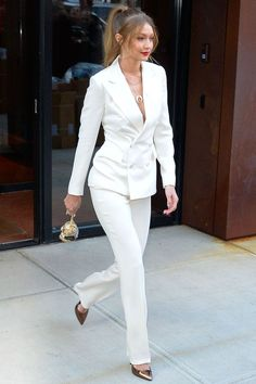 Gigi hadid from the big picture today's hot photos gigi hadid from the big picture today's hot photos suit up! The model rocks a white pantsuit with a high ponytail and gold heels as she leaves her apartment in nyc. White Pantsuit, White Trousers, Leather Trousers, Black Skinnies, Black Pants, Ladies Trouser Suits, Trousers Women, Pant Suits, Womens Trouser Suit