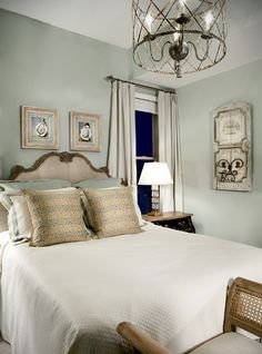 The guest room with walls painted a silver sage color and art reminiscent of French decor, would be welcoming for any company!