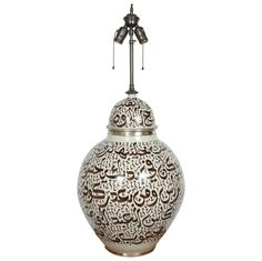 moroccan ceramic table lamp with ottoman arabic calligraphy inscriptions in brown and ivory - morocco - 1950s - HEIGHT: 34 in. (86 cm) DIAMETER: 16 in. (41 cm)