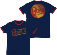 This vintage David Bowie concert tshirt is from his 1974 World Tour, which was performed to promote Diamond Dogs, Bowie's eighth studio album. Diamond Dogs reached number one in the UK and number 5 in the US, propelled by the single Rebel Rebel. Our men's blue cotton tee features Bowie World Tour 74 on the front, while the back spotlights Bowie's famous logo, with a red ringer around the neck and sleeves and washed out effects, for a true vintage look and feel. #davidbowie #bandtees…