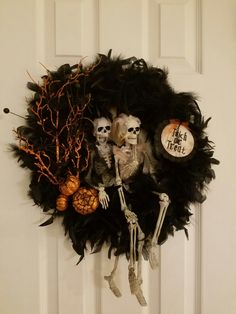 Till Death Do Us Apart  by Brenda needs wire wreath (dollar tree) 4 small feather boas (dollar tree) weave feather boas around wire wreath 2 skeleton (Big Lots) attached with black pipe cleaner picks ( Michaels ) sign (Michaels)  Black pipe cleaner use to attach skeleton