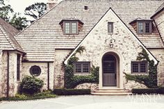 ivy on brick and a gorgeous extra-wide front door with square paneled windows