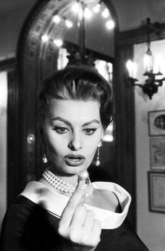 Sophia Loren is in awe of a 200 grain pearl ring at Cartier in Paris, she did not buy anything but was given a bronze Eiffel tower by the jewelry store, photo by Jack Garofalo, Paris, 1956