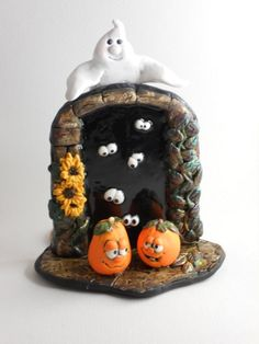 This piece is a Halloween door of polymer clay and air dry clay. The doorway is made of air dry clay painted with acrylics to resemble stone Polymer Clay Kunst, Polymer Clay Fairy, Sculpey Clay, Polymer Clay Projects, Halloween Fairy, Halloween Crafts, Halloween Scene, Halloween Door, Halloween Ornaments