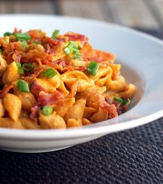 This healthy bacon and pumpkin pasta is made with a creamy pumpkin sauce, whole wheat pasta shells, and crumbled bacon. 300 calories per serving. | pinchofyum.com
